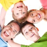 stock-photo-happy-family-father-mother-and-boys-over-white-background-79302121
